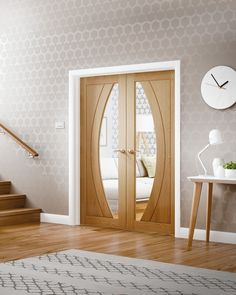 The Salerno door is a contemporary curved internal rebated unfinished oak door pair with clear glass.