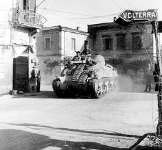 """An M4 """"Sherman"""" medium tank of the US 1st Armored Division in the small Italian town of Ponsacco, during the fight to break the Gothic Line, the last line of defense for German forces in Northern Italy."""