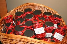 """Party Favors.  Babyfood jars filled with hot tamales (my daughters favorite candy) It says """"Our Ladybug says 'Thank You' with a hug"""""""