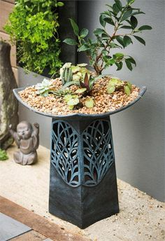 Give your garden birds an elegant place to visit with this modern pedestal bird bath. Sculpted from outdoor safe ceramic, this bath features a glazed exterior that has a glossy, green hue and cut-out tree design. The glaze keeps this piece looking fresh year round in outdoor climates. This modern piece is suitable as a birdbath, feeder or art piece wherever it sits. It measures approximately 15 inches in diameter and 18 inches tall.To light, requires 3 C batteries, sold separately…