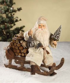Santa On Log Sled from The Holiday Barn Z