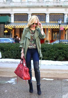 This picture shows a woman wearing military-esque fashion. It is interesting that the camouflage patterns have been reappropriated as part of the mainstream fashion, rather than their initial purpose which is for disguise in combat.