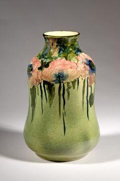 Vase, c. 1904. Poppies; glazed white clay; maker: Pauline Pottery, Chicago, then Edgerton, Wisconsin, 1883–1911; retailer: Marshall Field & Co., Chicago, 1852–2006; Gift No. 88, Mr. & Mrs. J. H. Leslie, 3344 Rhodes Ave., Chicago; H. 7 in. (2000-009).