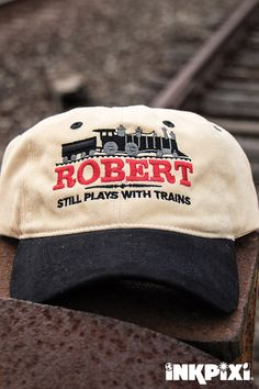 a0bcc2aa3ea Advertise your love for trains with you Still Plays with Trains custom hat.  Embroidered ...