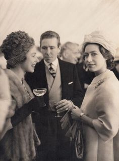 Queen Elizabeth chatting to Princess Margaret