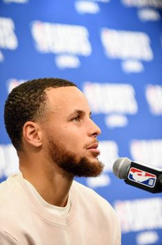Stephen Curry of the Golden State Warriors talks with media after the game against the New Orleans Pelicans during Game Four of the Western...