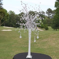 Eiffel Tower Vase with beaded flower stems and hanging beads.