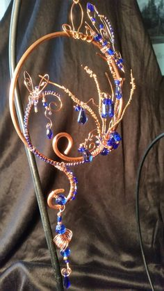 I love to create scenes with these Suncatchers. This one is Grasses and Wildflowers near a pond visited by two lovely Butterflies amidst swirls of hand~wrought Copper wires and Sapphire Crystals and C