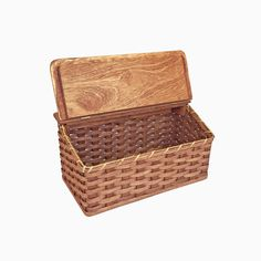 """Add a one-of-a-kind look to your kitchen. This handwoven wood breadbox is big enough to hold loaves of bread and other baked goods (also great for counter storage of dry goods or vegetables). There is no limit to the uses you can find for this unique box. This basket could be used to store almost anything from kid's toys to craft supplies to keep them neatly out of sight. Handwoven in the Heartland of the USA and signed by the Amish Crafter. Measures: 8 1/2"""" x 16 1/2"""" x 8 1/2"""" tall"""