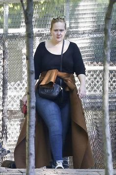 Easy: The Send My Love hit maker was dressed for comfort in a black scoop-neck long-sleeved T-shirt that gave a peek at her bra strap