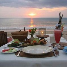 Romantic dinner on the beach.