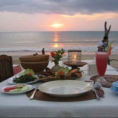 Romantic dinner on the beach.