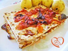 Lasagne di pane azzimo con stracchino e pomodori http://www.cuocaperpassione.it/ricetta/ff2f1f4c-9f72-6375-b10c-ff0000780917/Lasagne_di_pane_azzimo_con_stracchino_e_pomodori