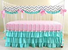 This bumperless crib set incorporates the perfect bit of chevron, paired with punchy colors and great for a modern #babygirl #nursery