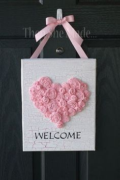 I really like this crackle paint idea. You could just do an uppercase letter for a kid's room or for your last name to hang in the entry of your house. And instead of ribbon roses, you could use buttons, even paper hearts/flowers. It's too cute.