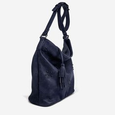 """Soft hobo shoulder bag with perforated fall floral and hematite studs detail. One main compartment with top zipper closure and tassel zipper pull. Outer zipper pocket on back of handbag. Additional smartphone, accessories and zipper pocket inside. Adjustable long shoulder strap. 100% PETA-Approved Vegan Leather Dimensions: 11"""" (L) x 12"""" (H) x 5"""" (W)"""
