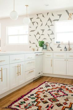 kitchen with patterned wallpaper and rug