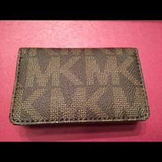 Michael Kors Card Holder Wallet Stylish Michael Kors Card Holder Wallet with MK Logo.  Holds your debit/credit cards, business cards, money, etc. Each side fits about 4-5 cards. No Trades. Michael Kors Bags Wallets