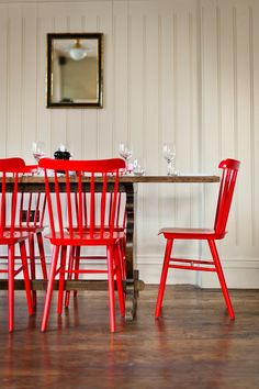 Bright red chairs. White clapboard walls.