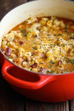 One Pot Chili Mac and Cheese - Two favorite comfort foods come together in this super easy, 30 min one-pot meal that the whole family will go crazy for!