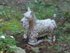 Scottish Terrier Statue in the Grotto of Lourdes, Emittsburg, Maryland by hikerpark