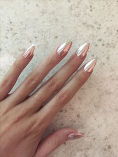 Rose gold chrome   achieved by using a melon pink base and silver chrome nail powder