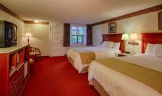 Spacious and comfortable guest room with two queen bed private balcony at the River Edge in Gatlinburg.