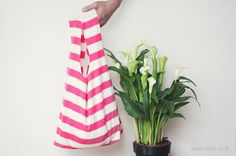 Always be prepared for a trip to the farmer's market with this take-anywhere tote repurpose from an old t-shirt.