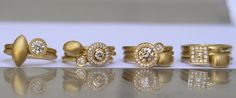 Stackable 22k gold rings with diamonds by Osnat Weingarten