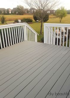 Deck and rails different color.  Same ugly rail as our deck.  Not sure if this would look good if I paint the under side white???