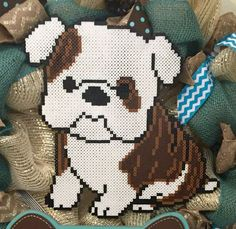 This is a deco mesh wreath with a perler bead design. Perfect for to celebrate your favorite pup! The dog bone sign is chalkboard so you can add your dogs name to personalize. The wreath frame is 18 I started out making princess designs out of perler beads to decorate my
