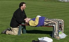 Actor Bill Murray gets an adjustment from a chiropractor on the golf course. Turn your power on anywhere :D