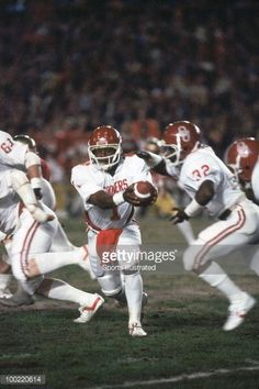 Oklahoma QB J.C. Watts in action, handoff to teammate Stanley Wilson vs Florida State. Miami, FL 1/1/1981