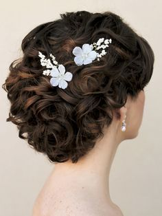 Image result for curly romantic glamorous bridal updo
