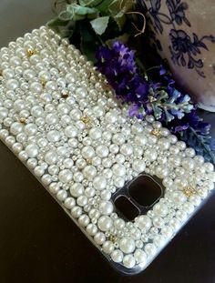 Capa/case para qualquer modelo de celular e smartphone, Escolha as cores de sua preferencia e eu personalizo para voce em pedras e cristais genuinos Preciosa.  Celulares de tamanho acima de 9cm X 15cm, acrescimo de 10% no valor .