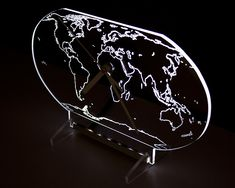 Clock with white backlight LED in the shape of the globe. New design.