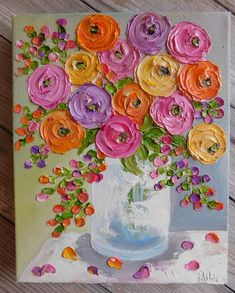 Fun bright colors of Ranunculus flowers to brighten your day!!! This is a small oil impasto painting where the flowers are thick and raised from the canvas. Size Painting: 8 x 10 Canvas Type: Gallery with a 1.5 edge Customs: If you would like a custom of this painting then you are