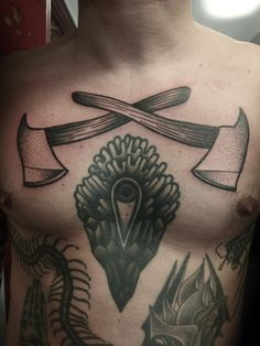 Rafel Delalande - fire axes on chest next to el Carlo tattoo and Rudy Frietsch