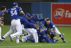 Russell Martin of the Toronto Blue Jays is mobbed by Melvin Upron Jr. and Kevin Pillar and teammates after the game-winning run scored in the tenth inning during MLB game action against the Texas. Get premium, high resolution news photos at Getty Images Hockey, Baseball, Softball, Kevin Pillar, Blue Jays Game, Russell Martin, Rogers Centre, Mlb Games, American League