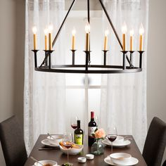 The nine-light chandelier brings rustic elegance to any room. It combines a rustic, old world finish with a traditional onyx and gold design to create a metal chandelier that is perfect for any dining