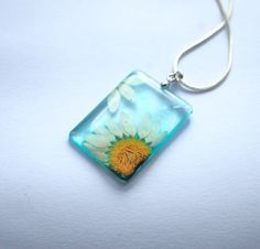 Pressed Daisy Flower Necklace Botanical Resin Jewelry Real Flower Rectangle Turquoise Blue Transparent Pendant 925 Silver Plated. $28.00, via Etsy.
