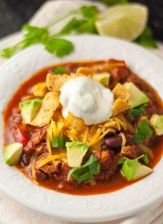 Chorizo Chicken Chili with Lime Cilantro Sour Cream recipe- this naturally gluten free recipe is so good it will win you cook offs. It has just the right amount of heat and the lime cilantro sour crea (Chicken Chili Gluten Free) Chili Recipes, Mexican Food Recipes, Soup Recipes, Cooking Recipes, Healthy Recipes, Best Chicken Chili Recipe, Chicken Recipes, Chorizo Chili Recipe Crock Pot, Chicken Chorizo