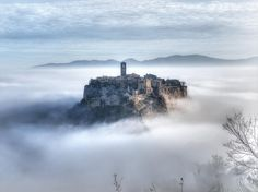 "Interesting in ""Photo"" ⭐ One of the most beautiful old towns in Italy, it is also disappearing. Civita di Bagnoregio, a quarter of the Municipality of Bagnoregio, is located on a Frozen In Time, Background Pictures, Art Background, Places Around The World, World Heritage Sites, Monument Valley, Rome, Tourism, Nature Photography"