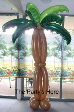 2 metre tall palm tree balloon sculpture. We're so proud of this one! It's awesome for photos too :) www.thepartyshere.com.au