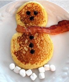 Christmas morning snowman pancakes - bacon scarf + chocolate chip eyes, nose, & buttons + marshmallow snow