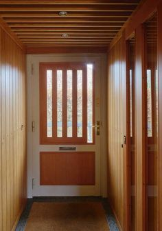 Mobile shades act as wooden peepholes in the front door