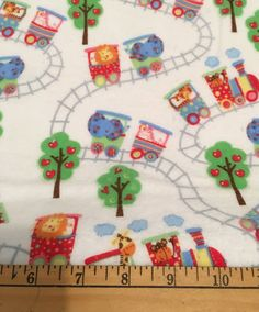 Zoo Train and Tracks Flannel Fabric by the yard. (PW)  Flannel fabric - Lightweight single sided and approximately 42 wide.  Perfect for: * Receiving Blankets * Backing for all Blankets * Bibs * Burp Cloths * Wash Cloths * Clothing * All types of projects!  The price for all fabric sold is in 1 yard increments. If more than 1 yard is purchased, it will come in one piece. If you have any questions, please feel free to contact me prior to purchase.  *** If a PW is added to the description, it…
