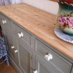 Antique pine sideboard in Annie Sloan Chateau Grey, decoupaged handles, and sanded scrub top.