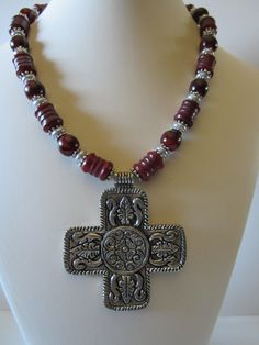 Statement necklace with Red New Jade carved tubes, red Buri seed beads and antique aluminum cross. Necklace is long, plus pendant drop. Free pair of earrings are long with leverbacks. Fall Jewelry, Summer Jewelry, Rustic Wedding Jewelry, Renaissance Jewelry, Religious Jewelry, Bohemian Jewelry, Seed Beads, Jade, Beaded Necklace