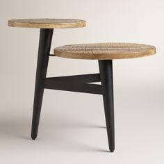 Our two-tier accent table features a unique black three-legged base and richly grained wood surfaces with a subtle gloss finish.